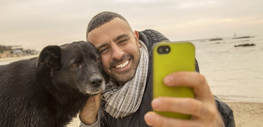 man taking a selfie photo with his dog.