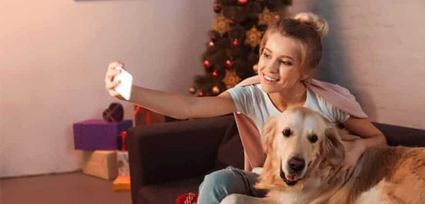 seasonal pet sitter taking a selfie with her dog