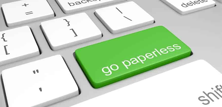Keyboard with button that says go paperless
